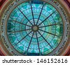 HARRISBURG, PENNSYLVANIA - JULY 5: Stained glass green dome in the Supreme Court Chamber in the Pennsylvania State Capitol building on July 5 in Harrisburg, Pennsylvania - stock photo