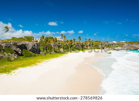 Harrismith Beach is one of the most beautiful beaches on the Caribbean island of Barbados. It is a tropical paradise with palms hanging over turquoise sea and a ruin of an old mansion on the cliff - stock photo