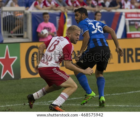 Harrison, NJ USA - August 13, 2016: Victor Cabrera (36) of Montreal Impact & Mike Grella (13) of New York Red Bulls fight for ball during MLS game between New York Red Bulls & Montreal Impact