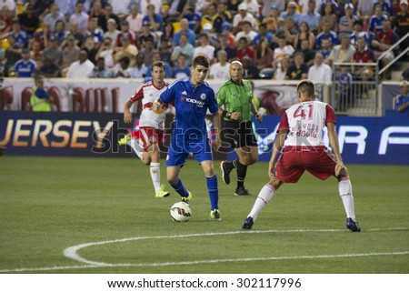 Harrison, NJ USA - July 22, 2015: Oscar (foreground) controls the ball during game between New York Red Bills and Chelsea FC at Red Bulls arena - stock photo