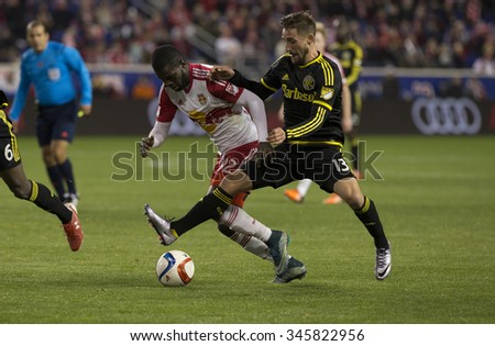 Harrison, NJ USA - November 29, 2015: Kemar Lawrence (92) of New Red Bulls fights for ball with Ethan Finlay (13) of Columbus Crew SC during MLS Eastern Conference Final at Red Bulls Arena - stock photo