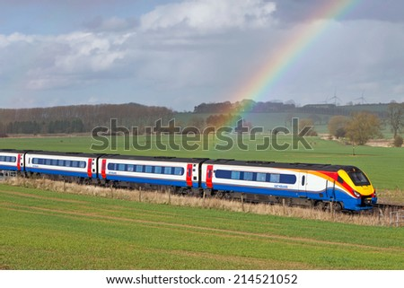 HARROWDEN, UK - MARCH 21: An East Mids operated express passenger service heads toward London on March 21, 2014 in Harrowden. East Mids operate a fleet of  108 unit sets calling at 87 network stations - stock photo