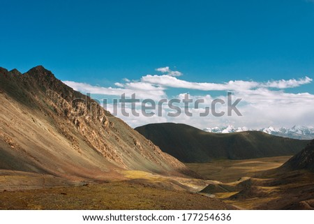 Harsh landscape with mountain range and the deep blue sky