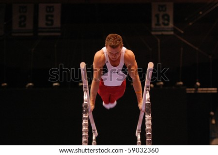 HARTFORD; CT - AUGUST 13: Gymnast Jonathan Horton performs on the parallel bars during the men's competition at the VISA Gymnastics Championships on August 13, 2010 in Hartford, CT. - stock photo