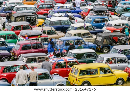 HARTLAND, DEVON, UK - August 1st 2010: Mini owners club rally brought together hundreds of the iconic mini-car. - stock photo