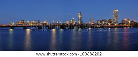 Harvard Bridge (AKA MIT Bridge, the Massachusetts Avenue Bridge, and the Mass Ave Bridge) and Boston skyline at night - stock photo