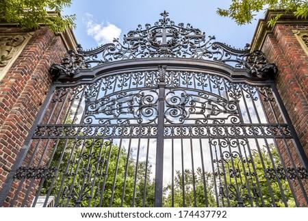 Harvard University's iron gate in Cambridge, Massachusetts, USA. - stock photo
