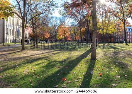 Harvard Yard, old heart of Harvard University campus, on a beautiful fall day in Cambridge, MA, USA on November 12, 2010. - stock photo