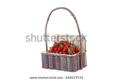 Harvest of fresh strawberries in a wooden basket. Isolated in white background. - stock photo