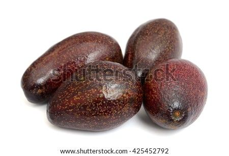 harvested red avocados isolated on white  - stock photo