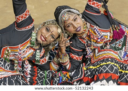 HARYANA, INDIA - FEBRUARY 12:Beautiful Kalbelia dancers in ornate black costume trimmed with beads and sequins on February 12, 2009 at the Sarujkund Fair near Delhi in India - stock photo