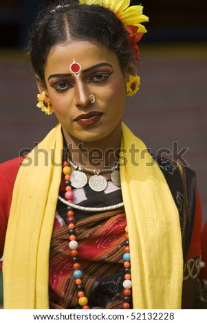 HARYANA, INDIA - FEBRUARY 12: Unidentified Indian dancer in traditional tribal outfit on February 12, 2009 at the Sarujkund Craft Fair in Haryana near Delhi, India. - stock photo