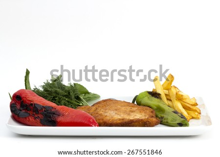 has served cooked chicken breast with red and green peppers on a plate - stock photo