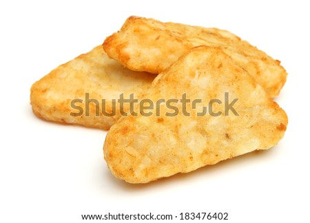 Hash brown potato patties on white background.