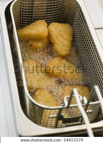 Hash Browns being Deep Fried in Corn Oil