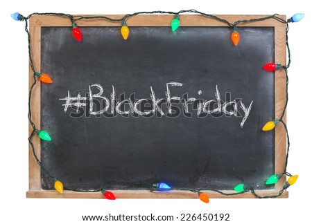 Hashtag Black Friday written in white chalk on a black chalkboard surrounded with colorful lights isolated on white - stock photo