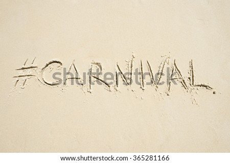 Hashtag social media message for carnival written in smooth sand on the beach in Rio de Janeiro, Brazil