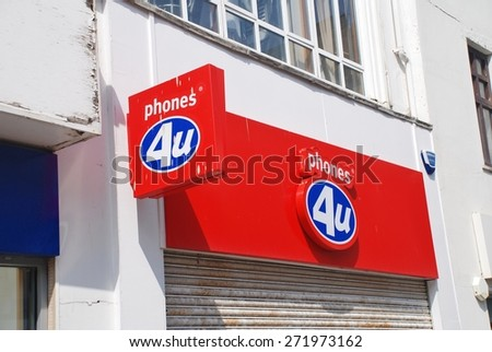 HASTINGS, ENGLAND - APRIL 22, 2015: The exterior of a Phones 4U mobile phone store. Founded in 1987, all 720 UK outlets closed down in September 2014 after the company went into administration. - stock photo