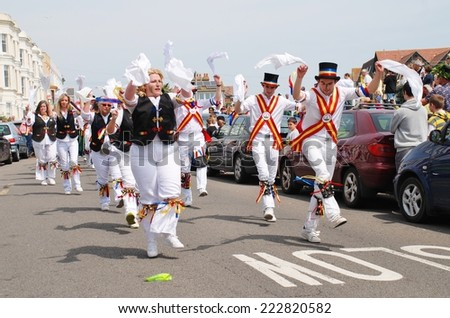 HASTINGS, ENGLAND - MAY 5, 2014: Mad Jack's Morris dancers perform at the parade on the West Hill during the annual Jack In The Green festival. The event marks the May Day public holiday in Britain. - stock photo