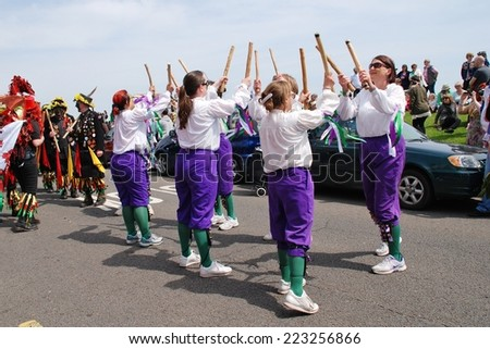 HASTINGS, ENGLAND - MAY 5, 2014: The Black Annis Morris dancers perform in the parade on the West Hill during the annual Jack In The Green festival. The event marks the May Day public holiday. - stock photo