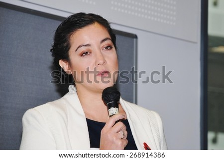 HASTINGS, ENGLAND - NOVEMBER 10, 2014: Sarah Owen, Labour party Parliamentary Candidate for Hastings and Rye, speaks at a public meeting. The General Election will be held in Britain on May 7, 2015. - stock photo