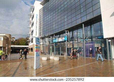 HASTINGS, ENGLAND - NOVEMBER 10, 2014: The exterior of the Sussex Coast College building in Station Plaza. The 22,000sq metre Sixth Form and Further Education college was completed in 2009. - stock photo