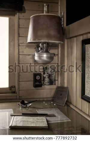 HASTINGS, MN - JULY 30, 2017: Corner of desktop in vintage railroad caboose, Personal mementos and objects used by railway workers during the 18 and 1900's era of transportation by railroad.