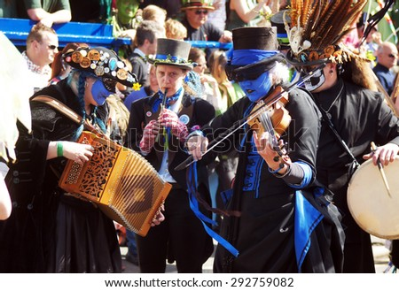 HASTINGS, UK - MAY 04, 2015: People play music with their costumes during the parade of traditional Jack in the Green Festival in Hastings UK.