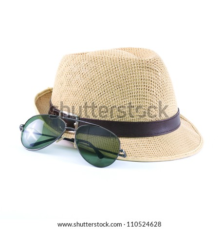 hat and sunglasses isolated on a white background