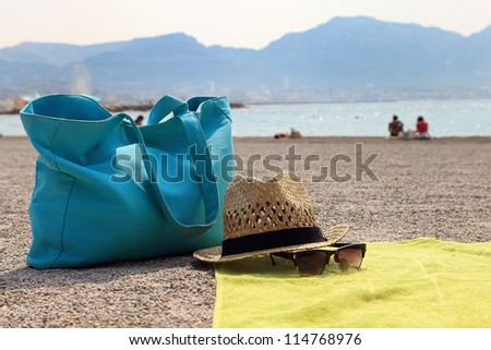 Hat, beach bag and the glasses on the rug