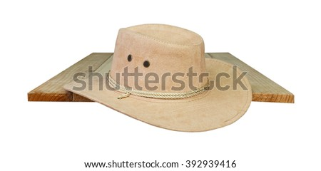 hat cowboy on wood white background.