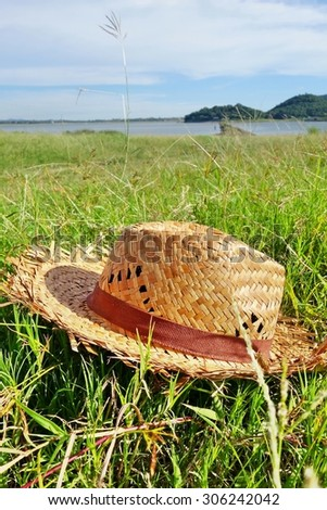 Hat on grass field, in sunlight