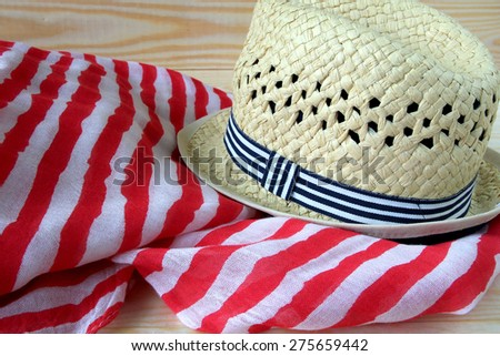 Hat on striped textile