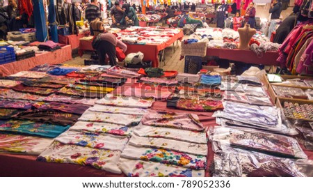 HATAY-Dortyol, Turkey - December 30, 2017: People are shopping at traditional street bazaar in Dortyol Town .. Dortyol is in town in Hatay Province.