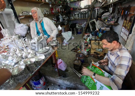 HATAY, TURKEY - AUGUST 21: Turkish woman shopping in historical place 'Uzun Carsi', on August 21, 2011 in Hatay, Turkey. Uzun Carsi is oldest and one of the most important shopping certer in Hatay.