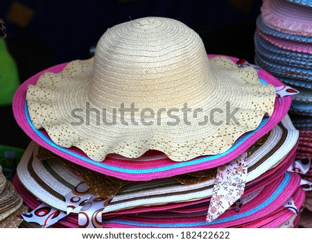 hats for lady at a market - stock photo