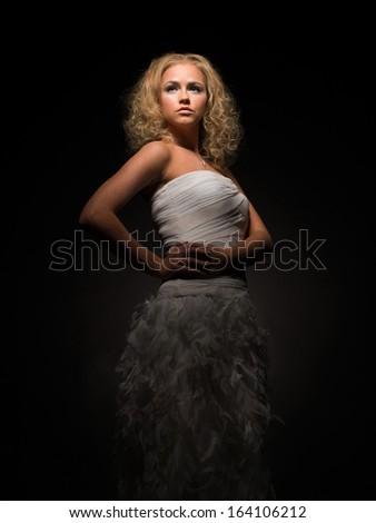 Haughty woman in luxury dress - stock photo