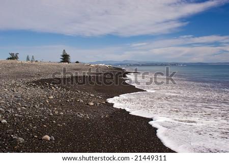 Haumoana Beach looking towards Napier City, Hawke's Bay, New Zealand - stock photo