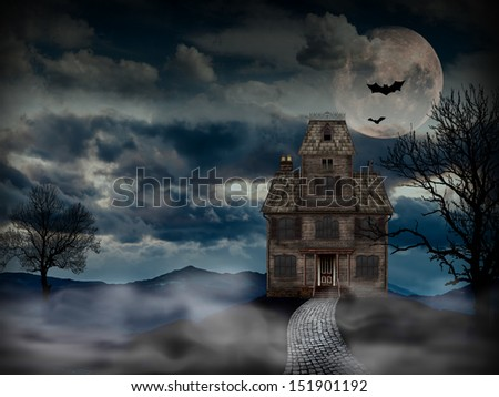 Haunted House with bats and full moon. Scary old house good for use in Halloween or horror projects. - stock photo