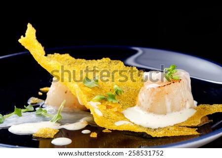 Haute cuisine, Gourmet food scallops on a corn crunch - stock photo