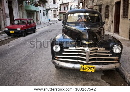 HAVANA-APRIL 15:Classic Chevrolet in a shabby neighborhood in Old Havana April 15,2012 in Havana.Before a new law issued on October 2011,cubans could only trade cars that were on the road before 1959 - stock photo