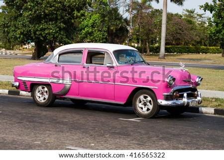 HAVANA - APRIL 27: Colourful old cars in Havana, Cuba on April 27, 2016 - stock photo