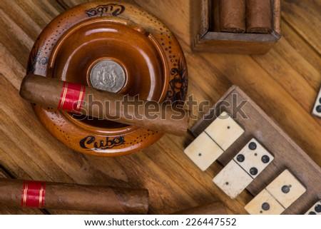 Havana cigar on wooden table - stock photo