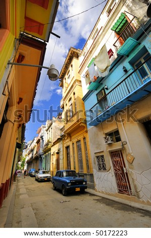 HAVANA - CIRCA DEC 2009. View of shabby street with colorful facades in Old Havana, declared by UNESCO World Heritage Site in 1982. Taken on Circa DEC 2009 in Havana, cuba. - stock photo