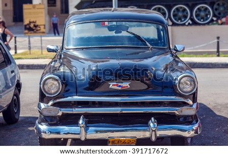 HAVANA, CUBA - APRIL 1, 2012: Black Chevrolet vintage car in front of Revolution museum