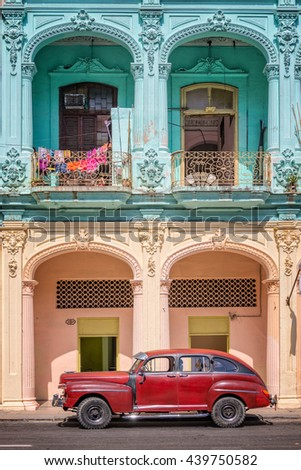 HAVANA, CUBA - APRIL 18: Classic vintage car and coloful colonial buildings, on April 18, 2016 in Old Havana - stock photo