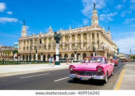 HAVANA,CUBA- APRIL 20,2016 :  Classic vintage car next to the beautiful Great Theater of Havana at the city downtown - stock photo