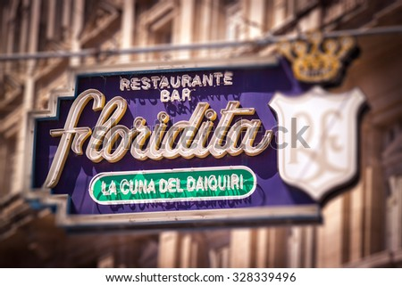 HAVANA, CUBA - CIRCA AUGUST, 2015: Sign of the historic Floridita restaurant in Havana. El Floridita was a favorite venue of Ernest Hemingway and the cradle (cuna in spanish) of the daiquiri cocktail. - stock photo