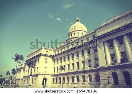 Havana, Cuba - city architecture. Famous National Capitol (Capitolio Nacional) building. Cross processed retro color style. - stock photo