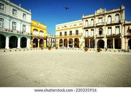 Havana, Cuba - city architecture. Renovated architecture at famous Plaza Vieja square. Cross processed color tone - retro style filtered image. - stock photo